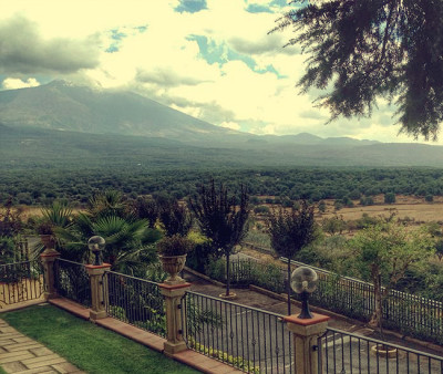 Places to visit in Italy, the city of Maletto with Mt. Etna on Sicily