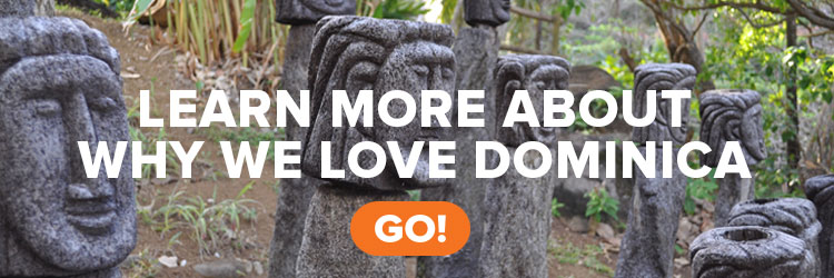 "Caribbean statues on the island of Dominica, with text ""Learn more about why we love Dominica"""