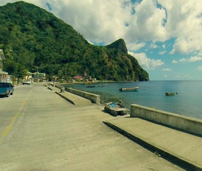The coastline road on Dominica, boats in the bay.