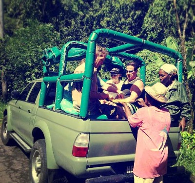 Experiential Travel ride in the back of a jeep, stopping for a snack of local fruits.