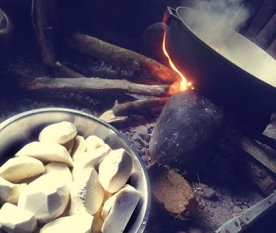 A steaming bowl over an open flame before the taro gets added.
