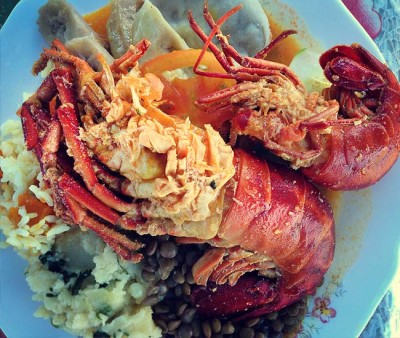 Amazing seafood of lobsters served over beans and taro in Dominica