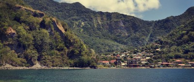A spectacular view of Dominica from Sea showing off how green the island is.